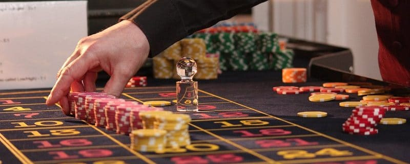 Croupier at roulette table