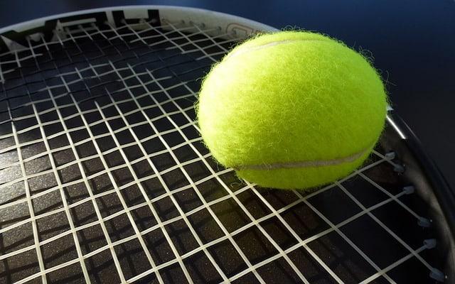 tennis ball on racquet