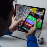 Man on phone with winning bet