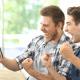 friends celebrate win