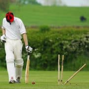 cricketer walking away from wicket