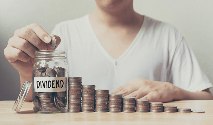 Putting coins into dividend jar