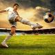 footballer kicking football
