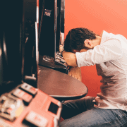 man losing at slots