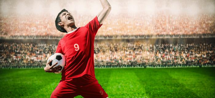 striker celebrating goal